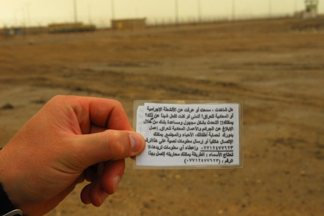 Laminated cards with the phone number to a new tip-line that is helping 1st Platoon Soldiers with D Company, 1st Battalion, 15th Infantry Regiment, 3rd Brigade, 3rd Infantry Division, gather information about the area straight from Iraqi citizens.