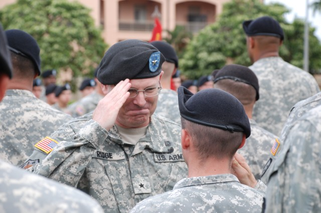 Brig. Gen. Ross E. Ridge, commandant of U.S. Army Field Artillery, greets a Soldier during his visit to 2nd Battalion, 11th Field Artillery Regiment, 2nd Brigade Combat Team, 25th Infantry Division. Ridge, a former member of 2-11 FA, was assigned as the 2nd Bde. fire support officer from 1993-1995 and deployed with the \'On Time Battalion' and 2nd Bde. to Haiti in support of Operation Uphold Democracy in 1994.