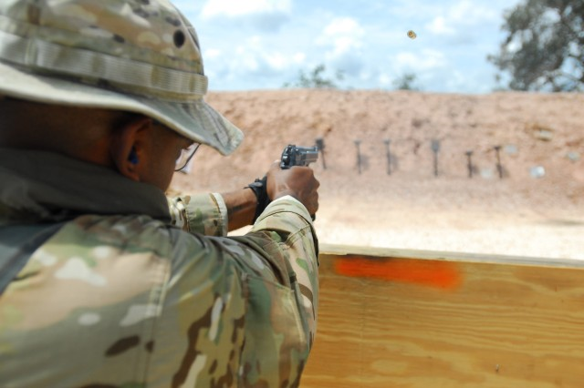 BELIZE CITY, BELIZE- A Belizean soldier assigned to the Belize Special Assignment Group (BSAG) fires his M-9 pistol at a row of mounted steel pop-up plates as part of a speed shoot exercise during a recent advanced marksmanship range session near Belize City, Belize. The timed exercise allows BSAG soldiers to improve on their speed and accuracy as they tried to knock down six steel plates as quickly as possible. Exercises like this are used by members of the Operational Detachment-Alpha, a group of U.S. Special Forces members from the 7th SF Group, to hone the military skills of their Belizean counterparts. The ODA is conducting counter-narcotics training with the Belizean Defence Forces in order to increase their ability to deter trafficking through Belize.  (U.S. Army Photo by Sgt. 1st Class Alex Licea, SOCSOUTH PAO)