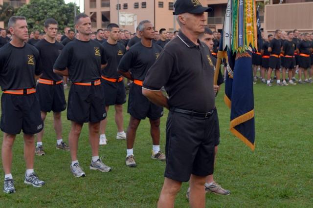 Jim McKinney, the 27th Infantry Regiment's honorary Command Sergeant Major, stands at parade rest in front of the regiment before the start of the regimental run May 4 at Schofield Barracks, Hawaii.  The Wolfhounds are celebrating their 109th birthday with an organizational week that includes the run, sporting events and a regimental photo.
