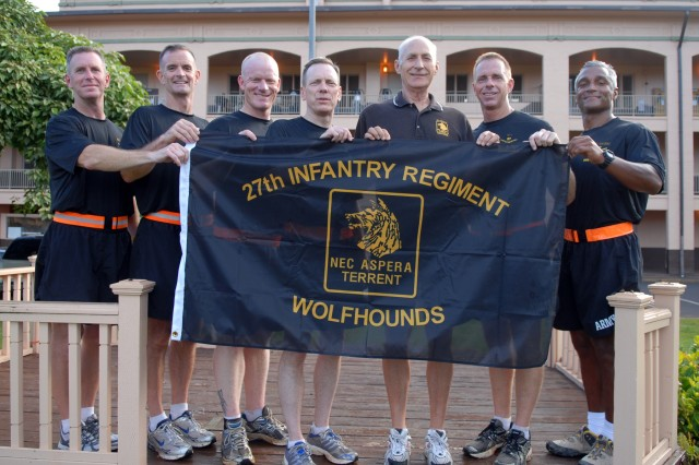 Six current and former 27th Infantry Regiment battalion commanders join the honorary regimental command sergeant major before the start of the regimental run May 4 at Schofield Barracks, Hawaii.  The Wolfhounds are celebrating their 109th birthday with an organizational week that includes the run, sporting events and a regimental photo.  In a unique coincidence, the four former battalion commanders are all currently assigned in Hawaii.  From left to right Col. Thomas Guthrie (former 2-27 commander); Col. Walt Piatt (former 2-27 commander); Lt. Col. Don Brown (current 1-27 commander); Maj. Gen. Bernard Champoux (former 1-27 commander, current commanding general, 25th Inf. Div.); Jim McKinney (honorary regimental command sergeant major); Lt. Col. Dan Wilson (current 2-27 commander); and Lt. Col. Raul Gonzalez (former 2-27 commander.)