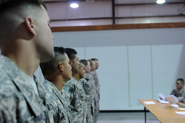 CAMP ARIFJAN, Kuwait - Noncommissioned Officers stand at ease while they receive feedback from the board members at the 53rd Infantry Brigade Combat Team, Soldier and NCO of the year board held here April 30. (Photo by Army Spc. Karen L. Kozub)