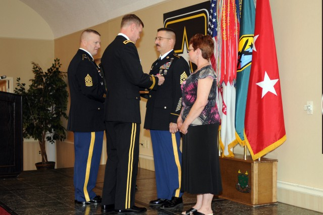 Sergeant Maj. Gregory D. Hartl, the 3d ESC's G-6 senior enlisted advisor, is presented the Legion of Merit for his meritorious service from Aug. 31, 2000 to Sept. 1, 2010 by Maj. Gen. James M. Milano, the Fort Knox commanding general, during the United States Army Armor Center and Fort Knox Retirement Ceremony Friday at the Leaders Club.  Now that he is retired, Hartl plans to make Swansea, Ill., his home and spend more time with his family. He has served overseas in Germany, Korea and Panama. (U.S. Army photo by Sgt. Michael Behlin)