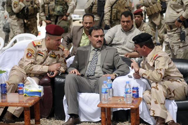 BAGHDAD - Sameer Al-Haddad, Secretariat of Receivership for the Government of lraq, talks to Iraqi Army Soldiers April 30 after a ceremony transferring Joint Security Station Ur from U.S. to Iraqi control. The JSS had previously been used jointly by Soldiers of 3rd Battalion, 69th Armor Regiment, 3rd Infantry Division, and Soldiers of 2nd Bn., 44th Brigade, 11th Iraqi Army Div. The four-month partnership between the forces was geared for this day, as the Iraqi Security Forces now continue operations on their own. (U.S. Army photo by Pvt. Emily Knitter, 1 AAB, 3ID PAO, USD-C)