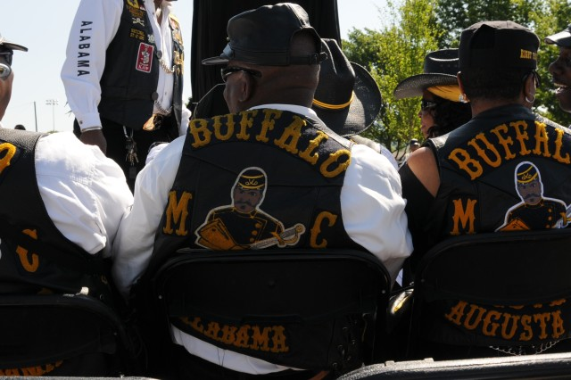 Members of the Huntsville Chapter of the Buffalo Soldier Motorcycle and Trooper Club gather before the ceremony begins.