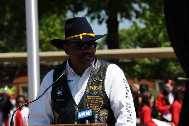 Huntsville Chapter of the NABSTMC President Alex Harrison makes remarks at Academy for Academics and Arts during the Buffalo Soldiers Memorial Monument Unveiling and Dedication ceremonies