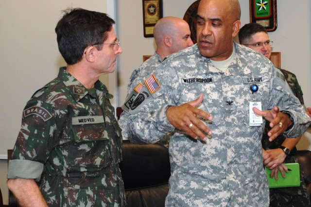 Col. Eric Witherspoon, U.S. Army South Information Operations' deputy chief of staff, speaks with Brazilian Army Col. Francisco Eduardo Medved after the opening ceremony to the staff talks. The staff talks will help strengthen cooperation and interoperability  between the two armies.