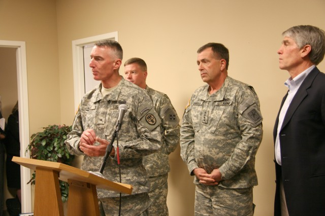 Brig. Gen. Gary Cheek, commander, Warrior Transition Command, addresses media at the Soldier and Family Assistance Center on Fort Carson, Colo., after visiting with Warrior Transition Unit Soldiers and leadership. Behind him are, from left, Maj. Gen. David G. Perkins, commanding general, 4th Infantry Division and Fort Carson; Gen. Peter Chiarelli, Army vice chief of staff; and Colorado Sen. Mark Udall; who also attended the visit and addressed media.