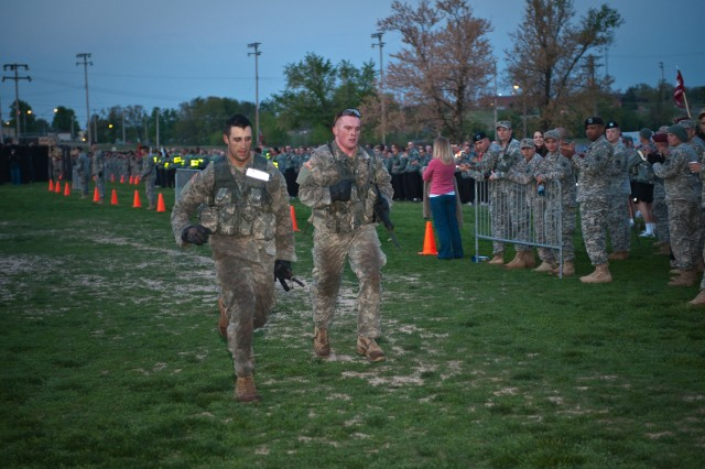First Lt. Garrett Hadad (left), 2nd Platoon leader, Engineer Co., and First Lt. Michael McLaughlin, executive officer, 66th Engineer Co., sprint to the finish line of the unknown distance run during the 6th annual Best Sapper Competition held at Fort Lenard Wood, Mo. April 19 - 21. (U.S. Army photo by Pfc. Robert England, 2nd Brigade Combat Team, Public Affairs.)