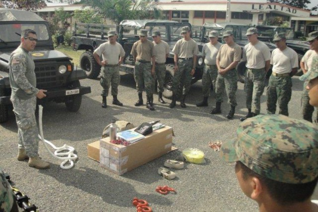 Chief Warrant Officer Rey Bolaños, maintenance officer with the U.S. Military Group's Joint Planning and Assistance Team, instructs members of the Ecuadorian Army 2nd Division on vehicle recovery operations.  This training evolution was conducted in partnership with the Ecuadorian armed forces and the U.S. Military Group to help increase the Ecuadorians military capabilities against illegal armed groups and narco-traffickers.