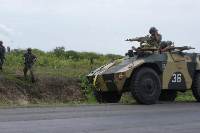 An Ecuadorian armored reconnaissance vehicle, or Jararaca, works closely with Ecuadorian infantry during a tactical road-march. The U.S. Military Group emphasized the importance of infantry-vehicle coordination during the training exercise which was conducted to help increase the Ecuadorians military capabilities against illegal armed groups and narco-traffickers.