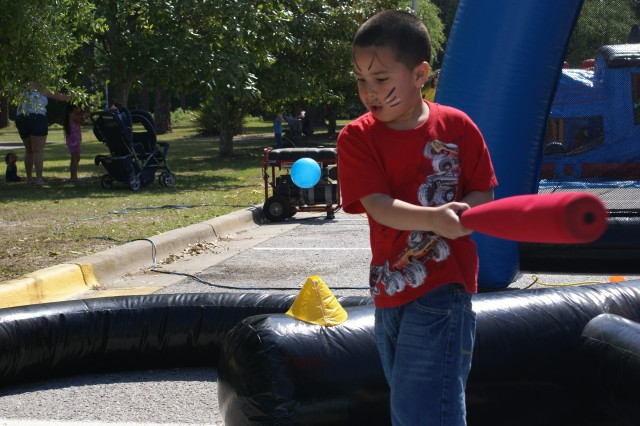 BodyLeopoldo Moreira, 6, son of Sgt. Berdy Moreira and Danery Moreira, takes a swing at a plastic ball at the baseball inflatable during the closing event of the Month of the Military Child at Fort Stewart.