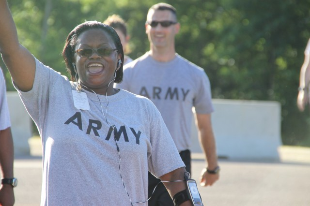 Lt. Col. Gwendolyn Lee, G-1, cheers for herself and her comrades as they finish the two-mile run during the FLIP kick-off event May 5.