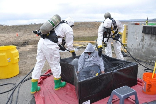 FORT WAINWRIGHT, Alaska - Victims of the hazardous materials spill were decontaminated by fire department personnel before being evaluated. The victims were then sent to local hospitals where they were decontaminated once again and treated for their injuries.