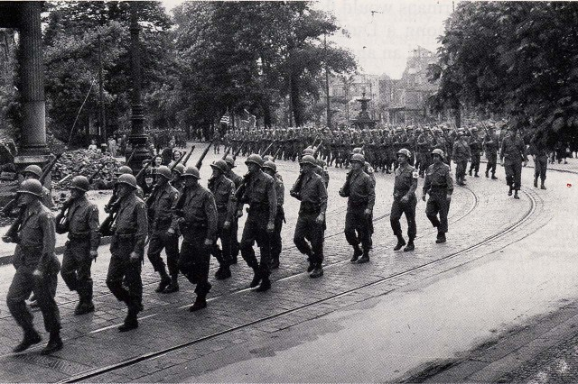 U.S. Soldiers march in a victory parade in Dusseldorf, Germany, on V-E Day, May 8, 1945.