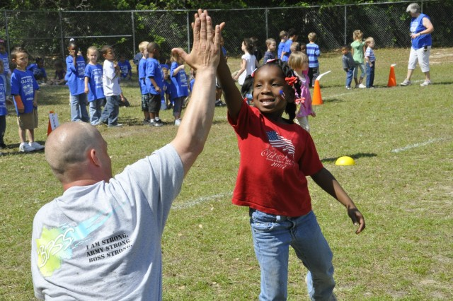 On April 29, Better Opportunity for Single Soldiers members participated in Brittin Elementary School Field Day activities. Staff Sergeant Phillip Phinesee, Sgt. Frank J. Carson, Spc. Frankie Nugent, Spc. Christopher Aker, Spc. Kyle Sparrow and Spc. Michael Bramhall frequent the school as part of an ongoing program where Soldiers volunteer to spend a few hours a week with the students and assist the teachers with whatever they have going on for the day.