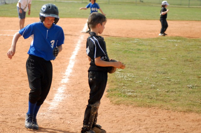 The Fort Benning Lightening Bolts' Andrew Reeves scores a run against the Black Knights Saturday at the Child, Youth and School Services Youth Sports Complex.
