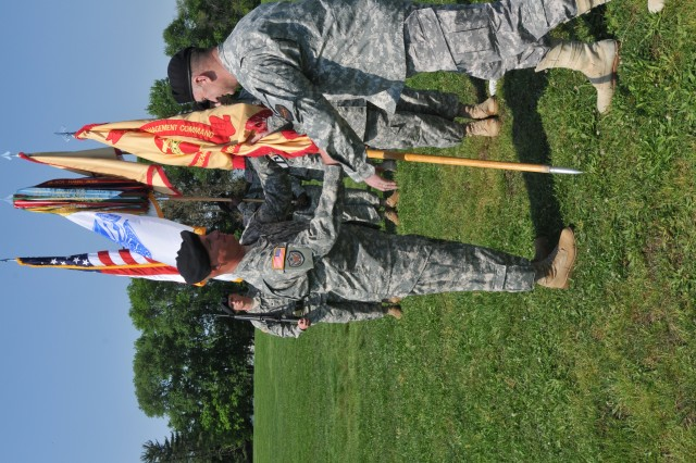 """Lt. Gen. Rick Lynch, IMCOM CG, passes the USAEC colors to incoming commander, Col. Scott D. Kimmell at a ceremony on May 6 at Aberdeen Proving Ground, Md."""""""