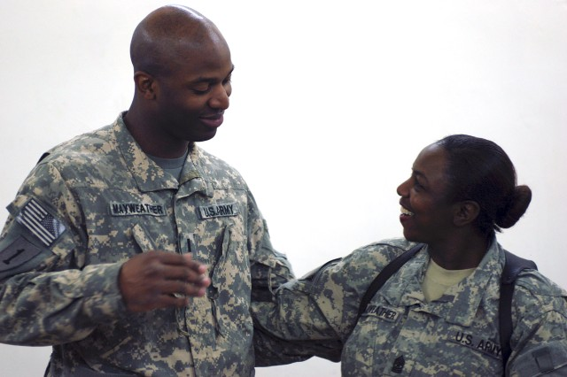CAMP TAJI, Iraq - First Lt. Kenieth Mayweather and his mother, Command Sgt. Maj. Rue Mayweather, greet each other May 5 at Camp Taji. Mayweather surprised her son with an early Mother's Day visit. (U.S. Army photo by Spc. Roland Hale, CAB, 1st Inf.