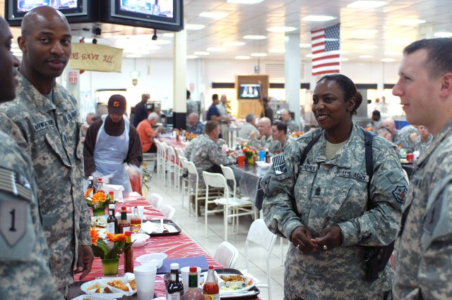 CAMP TAJI, Iraq - First Lt. Kenieth Mayweather introduces his mother, Command Sgt. Maj. Rue Mayweather, to friends May 5 after eating lunch at Camp Taji. The two were reunited in Iraq through an early Mother's Day surprise visit. (U.S. Army photo by Spc. Roland Hale, CAB, 1st Inf. Div.)
