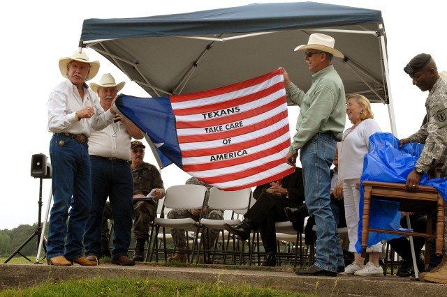 CENTERVILLE, Texas-Richard Wallrath (left), owner of the Champion Ranch, accepts a gift of appreciation for donating the use of his land during the annual Veteran Appreciation Day hosted by the 41st Fires Brigade and Leon County Veterans Service Office, May 1. The event honored veterans from all wars and thanked them for their service