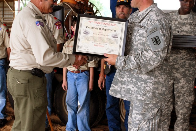 CENTERVILLE, Texas-Boy Scout Troop 6335 accepts a certificate of appreciation from Col. John Thomson, commander of the 41st Fires Brigade, during the annual Veteran Appreciation Day, here, May 1. Organizations that help the community were recognized during the event with certificates of appreciation
