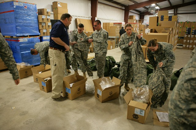 Soldiers try on cold weather gear during a Rapid Fielding Initiative April 27, 2010, in Buildings 2104.