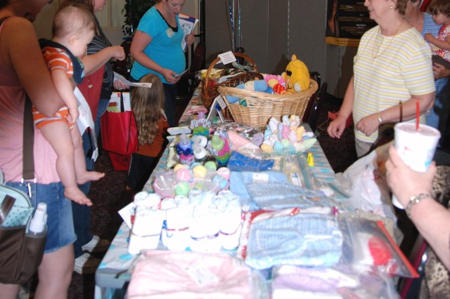 The Blue Bonnet Babies, a San Antonio based non-profit organization, provided many baby items and door prizes for the new moms and moms-too-be at this year's Operation Baby Shower held April 30 at Army Community Service.