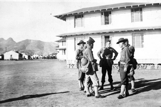 Capt. Lee James (center) talks with fellow officers before a training exercise at Fort Huachuca.