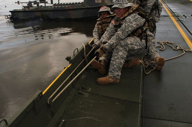 Louisiana National Guardsmen of the 2225th Multi-Role Bridge Company, 205th Engineer Battalion, construct a 300-foot temporary wharf that will be used to load boats with booms and supplies at Campo's Marina in St. Bernard, La., on May 6.