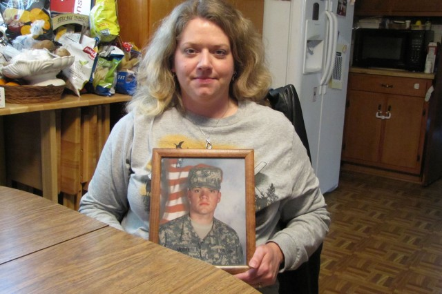 Cynthia Headrick holds a picture of her son, Pfc. Michael Moore, who will deploy to Afghanistan this summer.
