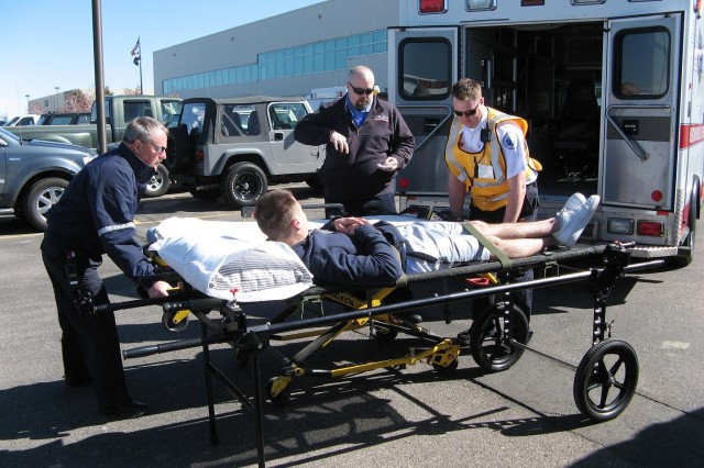 DENVER---Ambulances from around the Front Range wait their turn to receive patients and transport them to local Denver-area hospitals.