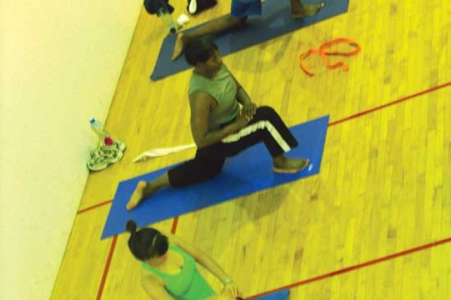 FORT SHAFTER, Hawaii - Pom Vogel, left, leads Sgt. Maj. Minnie Lacking and Chief Warrant Officer Cynthia Johnson-Owens, both of the 8th Human Resources Sustainment Center, in a yoga class at Fort Shafter Physical Fitness Center.