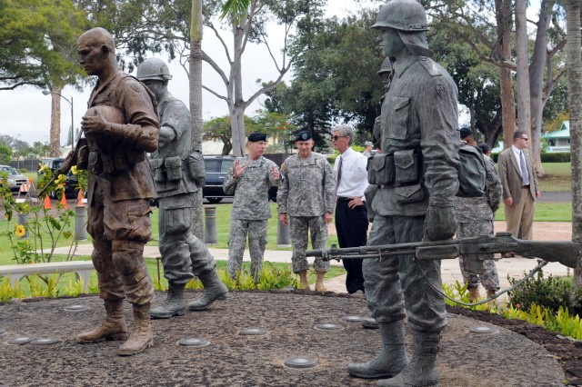 Maj. Gen. Bernard S. Champoux, commander of 25th Infantry Division, left, talks with Lt. Gen. Benjamin R. Mixon, commander, U.S. Army Pacific, and Secretary of the Army John McHugh, outside the headquarters of the 25th Infantry Division and Schofield Barracks, Hawaii, May 7. During the first week of May, McHugh visited USARPAC for the first time since being appointed Secretary of the Army, stopping in Alaska and Hawaii. McHugh took the trip to familiarize himself with the unique USARPAC mission. During a press conference at Schofield Barracks, McHugh said one of his main concerns as Secretary of the Army is Comprehensive Soldier Fitness - maintaining mental and spiritual fitness as Soldiers go through the stress of multiple deployments.