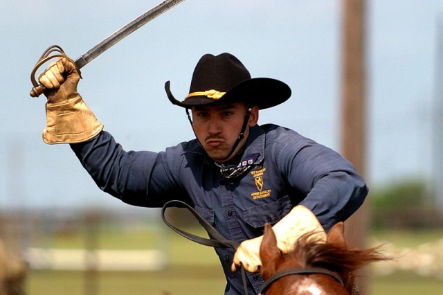 FORT HOOD, Texas-Sgt. 1st Class Filiberto Fernandez, the Horse Cavalry Detachment first sergeant, from Dallas, performs for veterans during the 865th Anti-Aircraft Artillery Battalion Association reunion April 29, at Fort Hood, Texas.