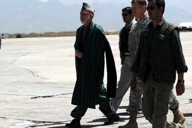 BAGRAM AIRFIELD, Afghanistan -- The President of Afghanistan Hamid Karzai and U.S. Army Gen. Stanley McCrystal, the commander of International Security Assistance Forces, arrive at Bagram Airfield, Afghanistan, May 8. Karzai visited Bagram just days before he's to travel to the United States to meet with the President of the United States Barack Obama. While Karzai was at BAF, he visited wounded Afghan and U.S. Soldiers at the Staff Sgt. Heath N. Craig Joint Theater Hospital and also addressed Servicemembers who are stationed there. (Photo by U.S. Army Staff Sgt. Susan Wilt, Combined Joint Task Force-82 Public Affairs)
