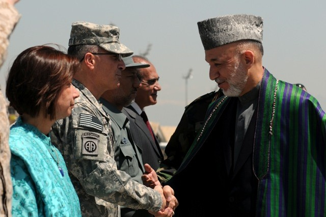 BAGRAM AIRFIELD, Afghanistan -- U.S. Army Maj. Gen. Curtis Scaparrotti, the commanding general of Combined Joint Task Force-82 and the 82nd Airborne Division, greets The President of Afghanistan Hamid Karzai upon his arrival to Bagram Airfield, Afghanistan, May 8. Karzai visited Bagram just days before he's to travel to the United States to meet with the President of the United States Barack Obama. While Karzai was at BAF, he visited wounded Afghan and U.S. Soldiers at the Staff Sgt. Heath N. Craig Joint Theater Hospital and also addressed Servicemembers who are stationed there. (Photo by U.S. Army Staff Sgt. Susan Wilt, Combined Joint Task Force-82 Public Affairs)