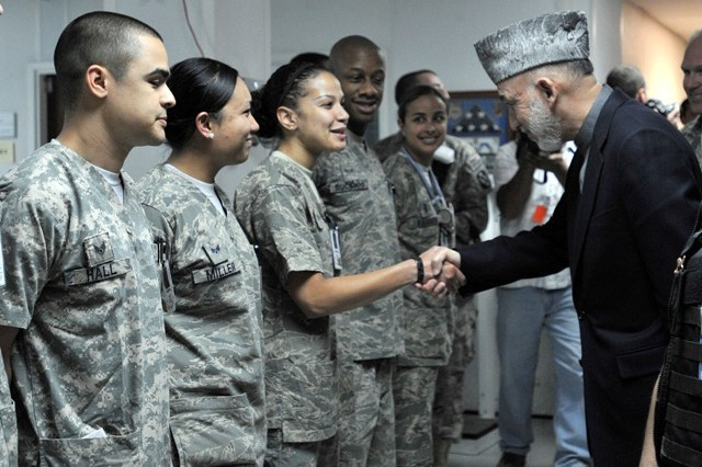 BAGRAM AIRFIELD, Afghanistan -- The President of Afghanistan Hamid Karzai shakes hands with U.S. Air Force servicemembers who work at the Staff Sgt. Heath N. Craig Joint Theater Hospital on Bagram Airfield, Afghanistan, May 8. Karzai visited Bagram just days before he's to travel to the United States to meet with the President of the United States Barack Obama. While Karzai was at BAF, he visited wounded Afghan and U.S. Soldiers at the hospital and also addressed Servicemembers who are stationed there. (Photo by U.S. Army Staff Sgt. Susan Wilt, Combined Joint Task Force-82 Public Affairs)