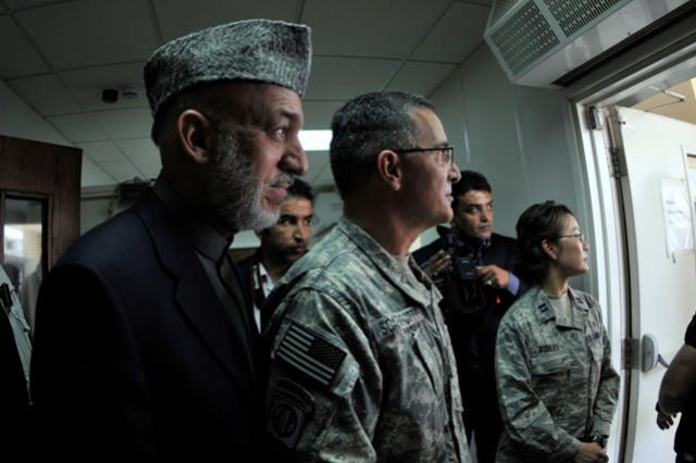 BAGRAM AIRFIELD, Afghanistan -- Afghanistan's President Hamid Karzai and U.S. Army Maj. Gen. Curtis Scaparrotti, the commanding general of Combined Joint Task Force-82 and the 82nd Airborne Division, wait for Karzai's introduction as he prepares to speak to the U.S. Troops at Bagram Airfield, Afghanistan, May 8. Karzai visited Bagram just days before he's to travel to the United States to meet with the President of the United States Barack Obama. While Karzai was at BAF, he visited wounded Afghan and U.S. Soldiers at the hospital and also addressed Servicemembers who are stationed there. (Photo by U.S. Army Staff Sgt. Susan Wilt, Combined Joint Task Force-82 Public Affairs)