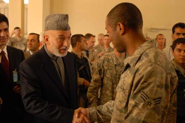 BAGRAM AIRFIELD, Afghanistan -- Afghanistan President Hamid Karzai greets a U.S. servicemember at the Staff Sgt. Heathe Craig Joint Theater Hospital here during a surprise visit to Bagram Airfield, Afghanistan, May 8. Karzai wanted to speak to U.S. servicemembers prior to flying to Washington D.C. next week to meet with his counterpart, U.S. President Barak Obama among other to discuss the current and future plans for Afghanistan. He also met with wounded Afghan National Army and U.S. servicemembers during the visit.  (Photo by Spc. Jay Venturini, 304th Public Affairs Detachment)