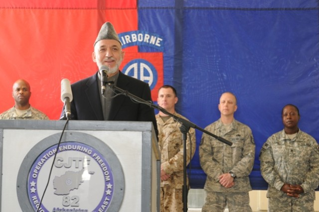 BAGRAM AIRFIELD, Afghanistan - President of Afghanistan, Hamid Karzai, speaks to Servicemembers who gathered at the Staff Sgt. Heathe N. Craig Joint Theatre Hospital during a visit to Bagram Airfield, Afghanistan, May 8. Karzai visited wounded Servicemembers and talked to Afghan National Army and Coalition Forces during his visit here.  (Photo by U.S. Army Spc. Charles J. Thompson, CJTF-82 Public Affairs)