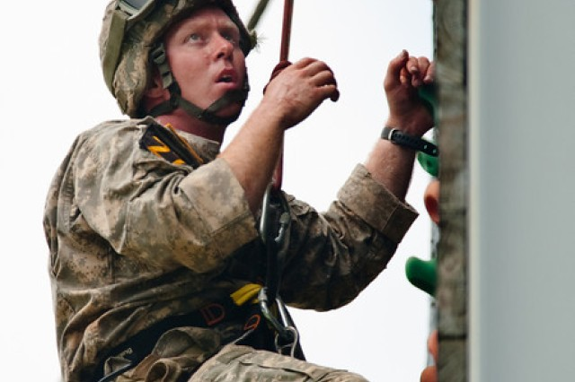 Cpt. Darrell Fawley of Best Ranger team 27 and the 199th Infantry Brigade climbs the rock wall during the Tri Tower challenge on day 2 at Todd Field.