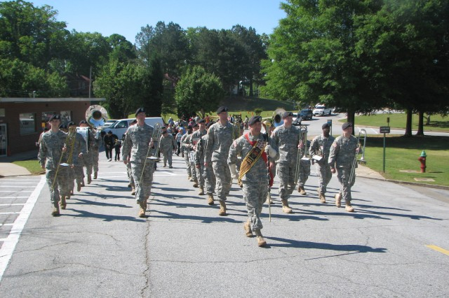 """Members of the Army Ground Forces Band lead the Children's Day Parade April 28 at Fort McPherson. The parade, themed """"Discover Science,"""" closed out the Month of the Military Child events on the base. Children dressed in self-made costumes to highlight different areas of science."""
