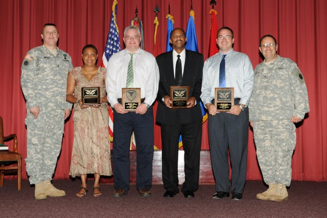 The U.S. Army Aviation & Missile Research, Development and Engineering Center's Aviation Applied Technology Directorate Commander Col. Thomas H. Bryant and Research, Development and Engineering Command Deputy Commanding General Brig. Gen. Harold J. Greene flank Commander's Award winners Lavonne F. Benton, Matthew P. Shivers, Harold B. Cuba and Thomas H. Watson at a ceremony May 5 at Ft. Eustis, Va.