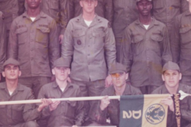 Ron Applewhite (center) poses with a platoon of basic trainees at Fort Polk in 1975. Applewhite was a drill instructor at Fort Polk during the Tigerland era.