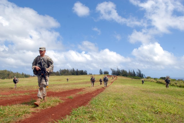 SCHOFIELD BARRACKS, Hawaii - Soldiers of the 3rd Squadron, 4th U.S. Cavalry Regiment, 3rd Brigade Combat Team, 25th Infantry Division move in a tactical formation through an open field at the Kahuku training during the squadron's Spur Ride April 27-28. The unit's new Cavalry troopers earned their spurs and increased their proficiency in troop leading procedures in the lush Kahuku environment.