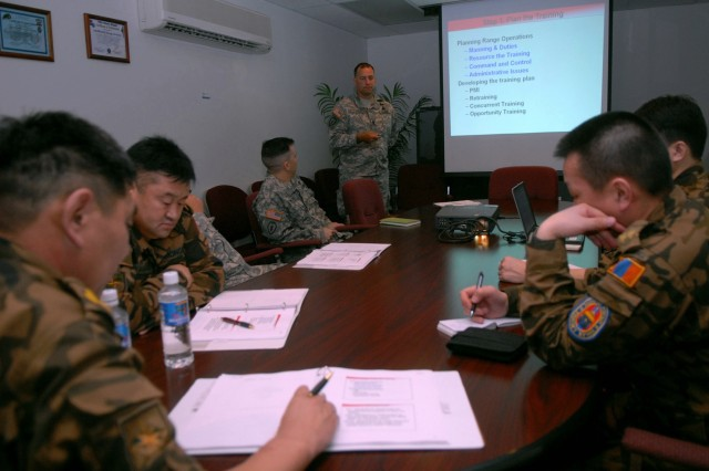 SCHOFIELD BARRACKS, Hawaii -Sgt. Maj. Troy Tuten, the master gunner and operations sergeant major for 3rd Squadron, 4th U.S. Cavalry, 3rd Brigade Combat Team, 25th Infantry Division gives a brief on the unit's range training procedures to four Mongolian training officers, Mar 10. The visit allowed the officers to receive a fresh view on current U.S. Army range training procedures while also fostering the relationship between Mongolia and United States Army Pacific Command (USARPAC).