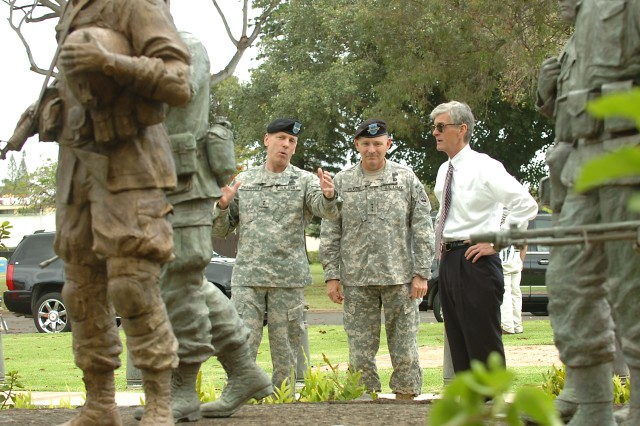"Maj. Gen. Bernard Champoux, commanding general, 25th Infantry Division (left) and Lt. Gen. Benjamin Mixon, commanding general, U.S. Army Pacific (center), explain the signifigance of the ""Tropic Lightning Memorial,"" a set of statues honoring the sacrifice of fallen 25th Infantry Division Soldiers during combat, to the Honorable John M. McHugh, Secretary of the Army, at Schofield Barracks, Hawaii, May 7. Secretary McHugh visited Division leaders, Soldiers and families after the Defense Department announced the Tropic Lightning Division will return to Iraq this fall. (U.S. Army photo by Spc. Jesus J. Aranda, 25th Infantry Division Public Affairs Office)"