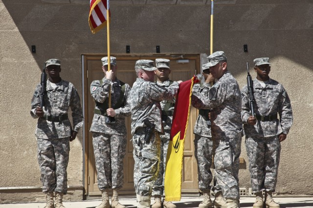 CAMP TAJI, Iraq—Col. Douglas Gabram (center), from Cleveland, commander, 1st Air Cavalry Brigade, 1st Cavalry Division, cases the brigade colors with Command Sgt. Maj. Glen Vela (second from right), from Dallas, brigade command sergeant major, following the Transfer of Authority ceremony with the Combat Aviation Brigade, 1st Infantry Division, April 15 at Camp Taji, Iraq.