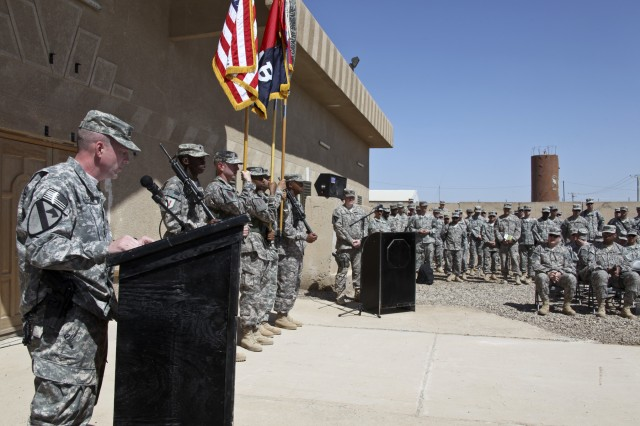 CAMP TAJI, Iraq—Col. Douglas Gabram (center), from Cleveland, commander, 1st Air Cavalry Brigade, 1st Cavalry Division, addresses Soldiers from the 1st ACB and Combat Aviation Brigade, 1st Infantry Division, following the Transfer of Authority ceremony between the aviation units, April 15 at Camp Taji, Iraq.